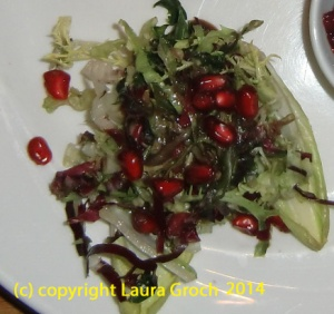 pomegranate seeds on salad