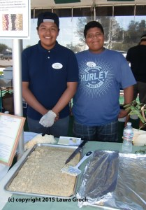 Rafael Castillejo and Javier Reyes of Reality Changers volunteered at the lima bean festival, serving Mary Dralle's Lemony Lima Poppyseed Cake. (Photo by Laura Groch)
