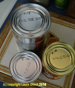 Marking dates on cans and bottles as they come into the pantry helps you keep rotating the older items to the front. Photo by Laura Groch
